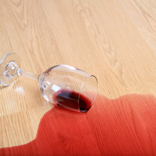 Wine stain on Laminate floor | Speers Road Broadloom